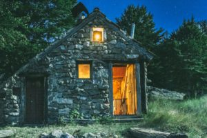 very old tiny stone house in nature park dinara in croatia, photographed during night.