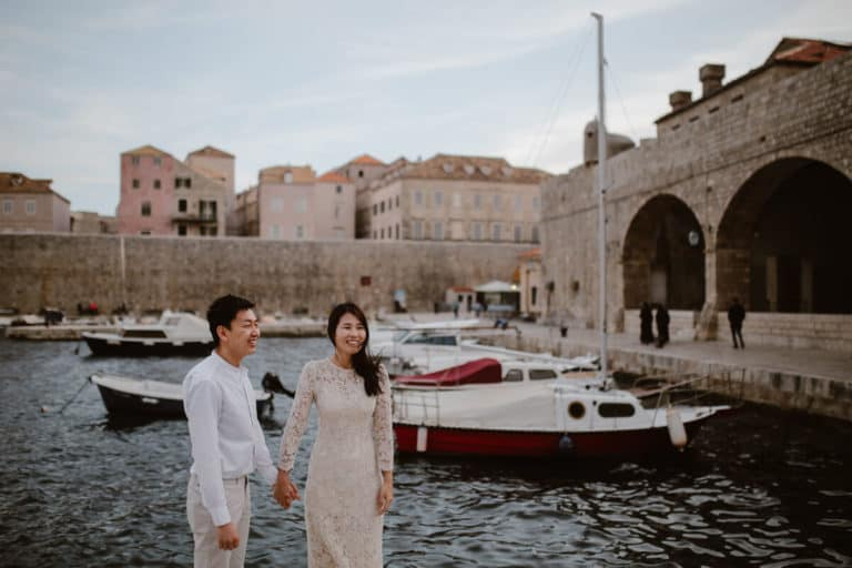 Dubrovnik for couples - a photo of a couple in old port in Dubrovnik.
