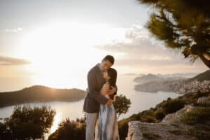couple hugging in park orsula near Dubrovnik during their honeymoon in Croatia.
